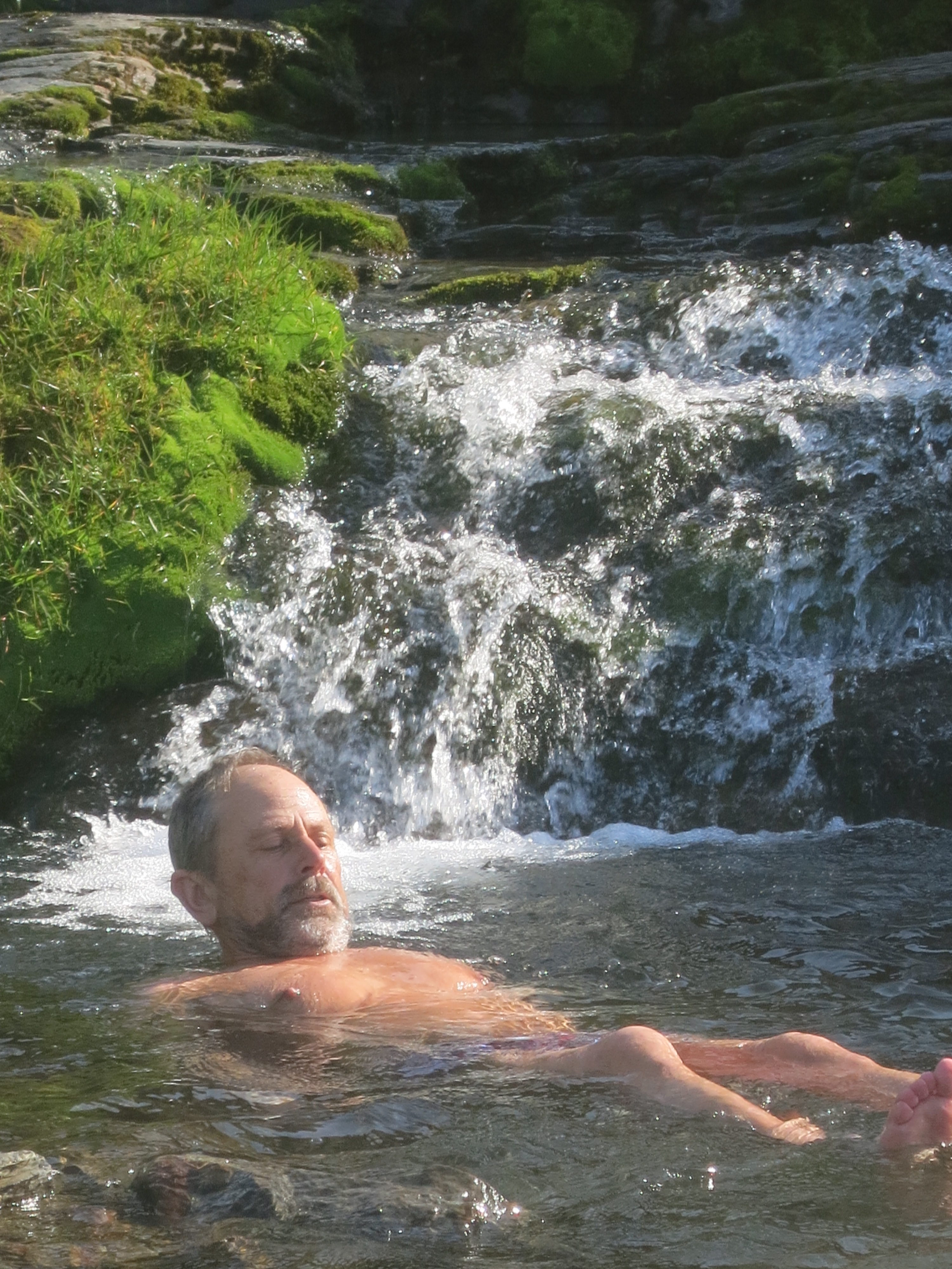 Mats swimming in the streams on Shackleton's Hike from Fortuna Bay (by Rod Macfarlane)