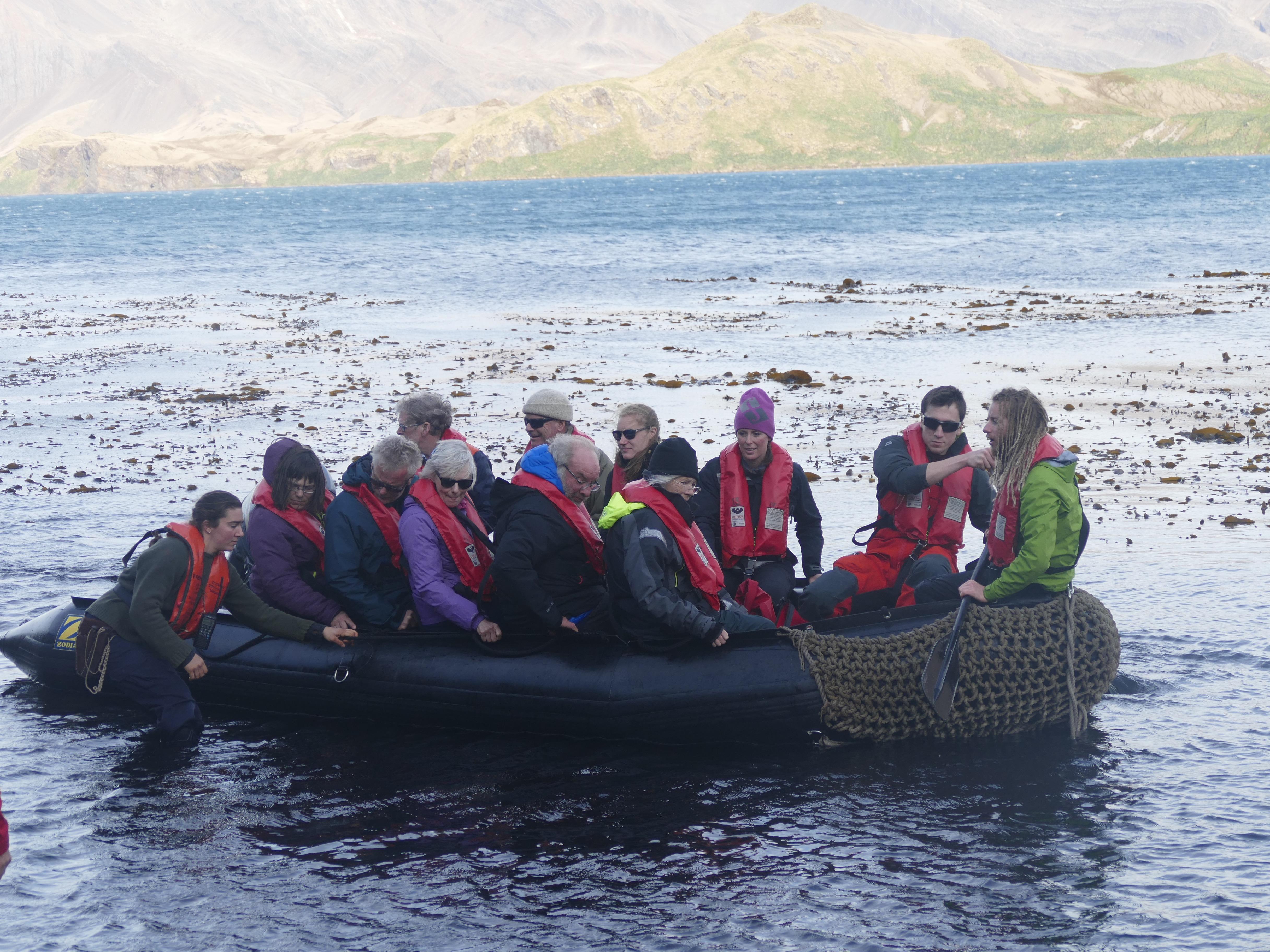 Katelynn pushing the zodiac through thick kelp at Stromness