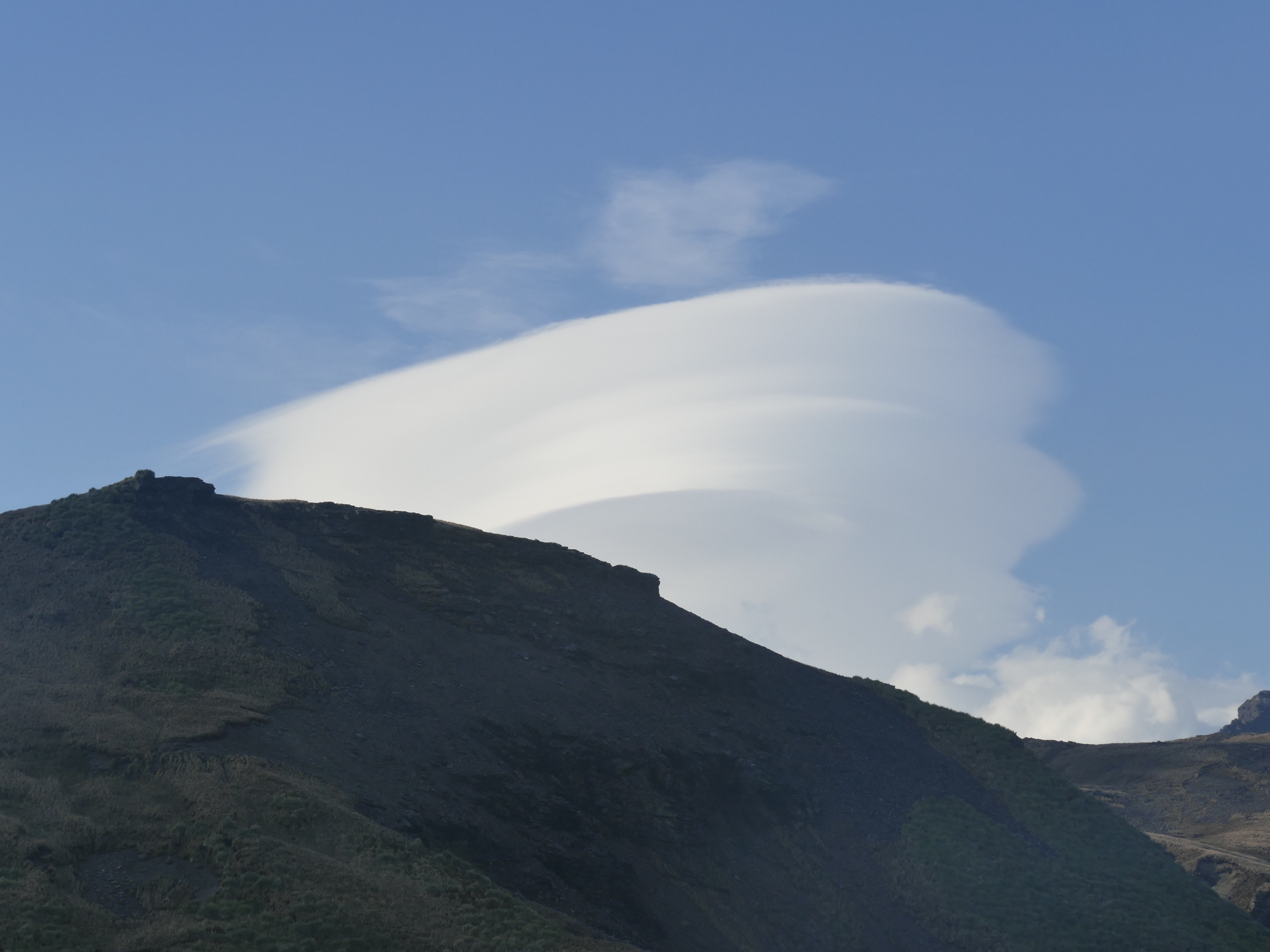 Lenticular clouds over the eastern arm of Fortuna Bay