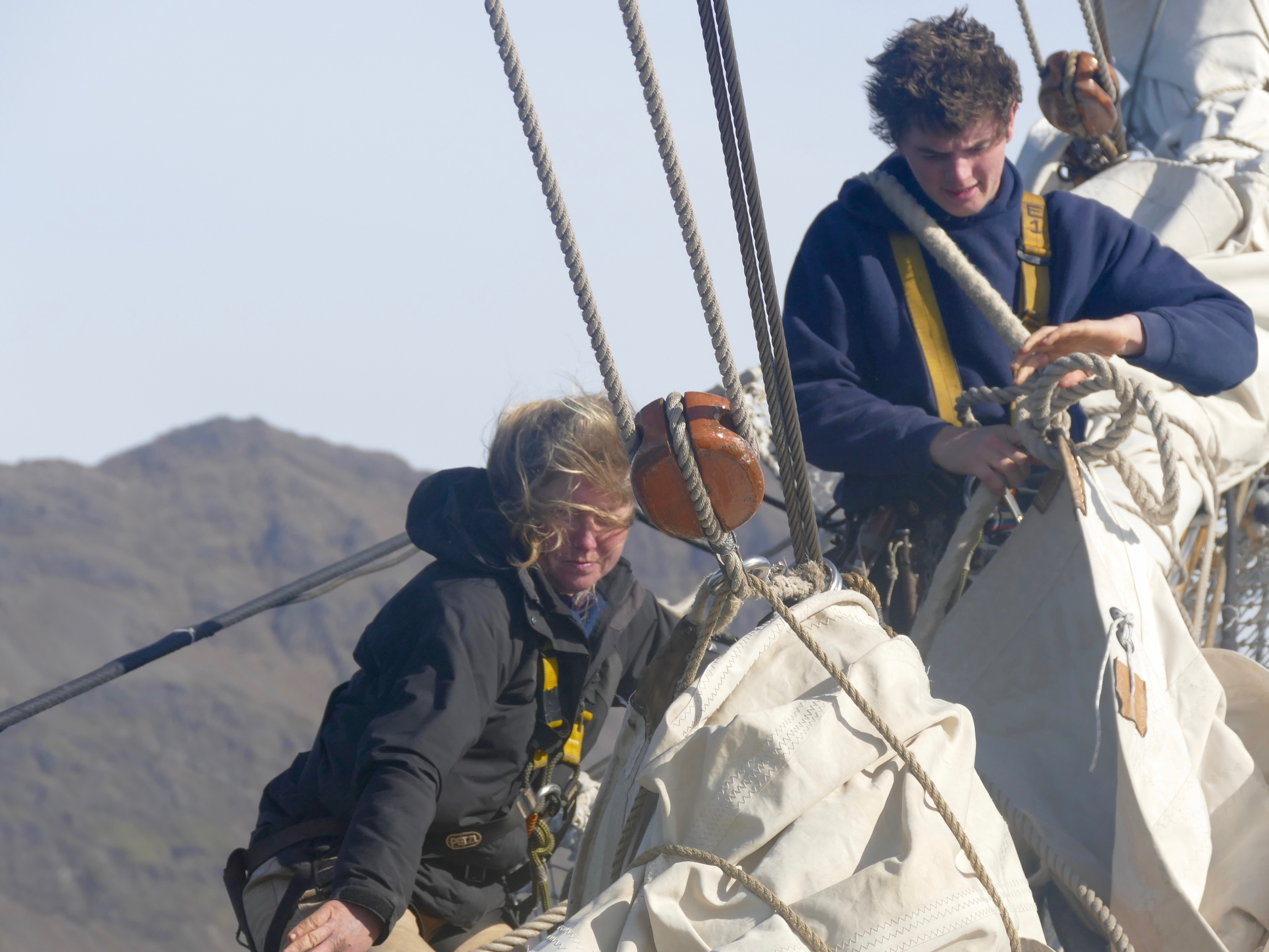 Megan and Toby fixing the headsails as we arrive in Stromness from Fortuna Bay